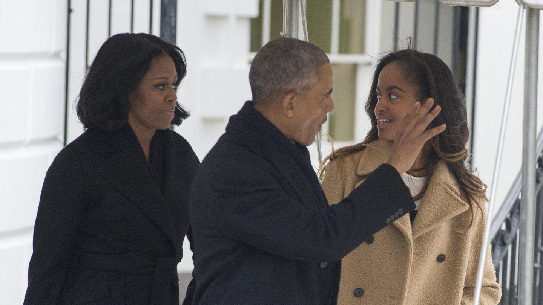 Michelle und Barack Obama mit Tochter Malia